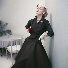 Sunny Harnett wearing suit with circle skirt, June 1952