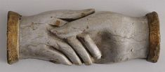 AMERICAN FOLK ART CARVED AND PAINTED MODEL OF CLASPED HANDS