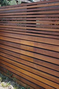 Is it just us, or is this one of the most stunning fences you've seen in a long while? Made out of ipe, a sustainably harvested Brazilian hardwood, in two thicknesses, we think it's the fact that boards are laid horizontally that makes it so uniquely gorgeous. Its practically beach-side location doesn't hurt, of course. see more photos below the jump
