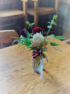 Old Mill Wedding, old stonework. Locally sourced wedding. Locally grown flowers. Burgundy, creams, dahlias, ranunculus,crab apples, roses.