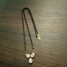 Buy Artificial Short Mangalsutra from Wedding Jewelry, Gold Jewelry, Beaded Jewelry, High Jewelry, Jewelery, Jewelry Necklaces, Diamond Mangalsutra, Mangalsutra Design, Long Pearl Necklaces