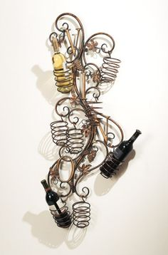I need this, I never have anywhere to put my wine it sits on the counter yelling at me until I drink it - spiral wine rack from CBK Home Accessories