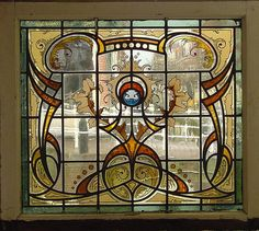 So beautiful.....gridded art nouveau stained glass window