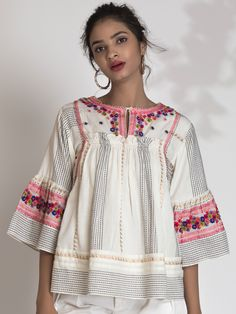 Handloom Cotton Blouse in dobby pattern with temple border in Zari. Intricately embroidered signature florals with hand tucked french knots adds to the luxury. Cotton Kurties, Cotton Blouses, Western Outfits, Western Wear, Little Girl Dresses, Girls Dresses, The Office Shirts, Designer Party Wear Dresses, French Knots