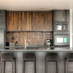 Rustic bachelor kitchen: rod iron, aged oak and black leather.