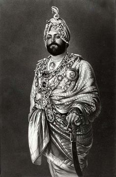 Maharajah Dalip Singh (1838 – 1893) dressed for a State function, c.1875.  Later nicknamed the Black Prince of Perthshire, he was the last Maharaja of the Sikh Empire. He came to power after a series of intrigues, in which several other claimants to the throne & the Koh-i-Noor diamond, killed each other. After his exile to Britain at age 13 following the British annexation of the Punjab, he was befriended by Queen Victoria. In 1850, the Koh-i-noor Diamond was confiscated by the British.