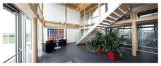 STRABAG office building Hausleiten (Lower Austria), entrance Pole Barn Homes, Pole Barns, Concrete Footings, Roof Beam, Beams, Entrance, Office Buildings, Construction, Austria