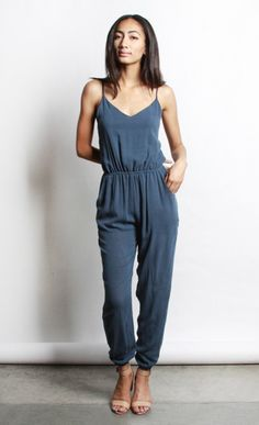 """Minimal jumper with a v neckline and open back. Elasticated waistband and bottom of pants. Thin spaghetti straps. Side pockets. Slightly loose fitting silhouette. Model is 5'7"""" and is wearing a size s"""