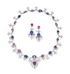 A SET OF SAPPHIRE, COLORED SAPPHIRE AND DIAMOND JEWELRY Comprising a necklace, suspending an oval-cut pink sapphire, weighing approximately 4.00 carats, within a marquise-cut diamond surround, to the neckchain designed as a series of oval-cut variously-colored sapphires, spaced by circular-cut diamond V-shaped links, with marquise-cut diamond accents; and a pair of ear pendants en suite, 16 ins. (necklace), 1 5/8 ins. (ear pendants), mounted in platinum
