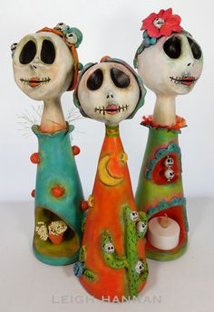 an enchanting trio of clay skellies (two can use flameless tea light candles); see more at etsy.com/shop/skellychic!  #OhMyBiz