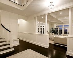 Beautiful wainscoting and columns frame the living room and dining room.