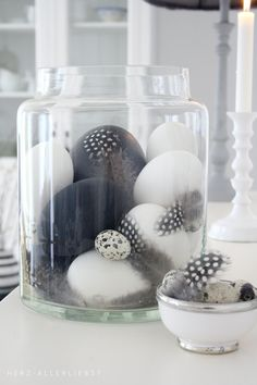Shades of Gray ~ for modern holiday decor place black and white eggs in a glass hurricane with some matching feathers...