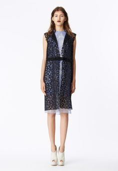 LOOK 14 Black honeycomb lave sleeveless coat. Cornflower blue organza tapestry sheath dress with black cotton poplin waistband.