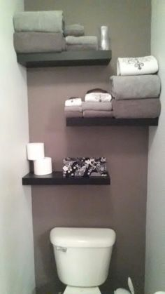 Master bath toilet closet.  I painted the accent wall,  bought 3, 23 inch floating shelves from target and stagger hanged them myself.  I covered a shoe box with left over fabric from my roller shade using modge podge.  The box stores my feminine stuff so that is handy and pretty.
