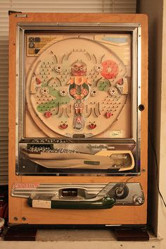 Vintage Nishijin Pachinko Machine. My dad brought one home from one of his many trips overseas. I loved, loved, loved, loved, LOVED playing with it. I could sit and watch it for hours. I was easily amused, but I also love physics. *G*