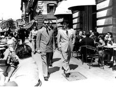 News Photo: The Italian American gangster Lucky Luciano walking with…