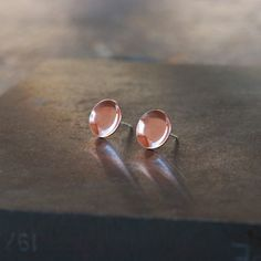 Bright, curved copper cups create a striking play of light and reflectivity in these simple, easy earrings. Sterling Silver posts are soldered Copper Earrings, Stud Earrings, Copper Cups, Black Diamond Engagement, Alternative Engagement Rings, 14k Gold Ring, Studs, Handmade Jewelry, Copper Cleaner