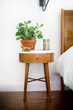 bedroom. Love this side table and succulent!