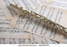 Flute on music notes background - stock photo