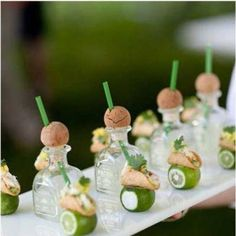 mini patron bottles with straws//tacos & limes... not necessarily appealing to me but a clever presentation