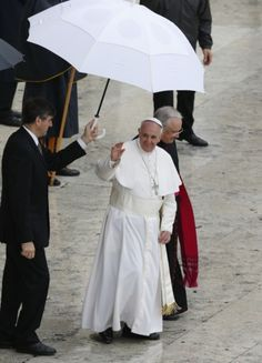 Pope waves after celebrating Mass for members of confraternities in St. Peters Square  Pope Francis waves as he leaves during rainy weather after celebrating a Mass for members of confraternities in St. Peters Square at the Vatican May 5. The pope praised confraternities as a means of transmitting and cultivating the faith but said popular piety must be practiced in communion with the pastors of the church. (CNS photo/Paul Haring)