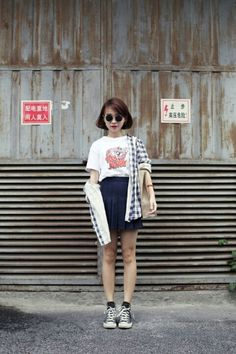 School style - mini pleated skirt - graphic tea and sneakers (Seoul street style)