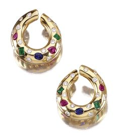 PAIR OF GEM-SET AND DIAMOND EAR CLIPS, TIFFANY & CO Each of hoop design inset with scattered brilliant-cut diamonds, interspersed with pear- shaped rubies, step-cut emeralds and an oval sapphire, signed T & Co to clip fitting.