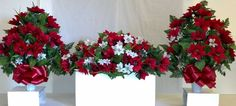 Headstone flower arrangement package for Christmas.  Includes a headstone saddle arrangement to place on top of the grave marker, and two matching vases to go on either side.