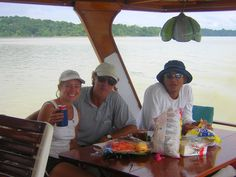 Aboard Trimaran Ladyhawke. World adventurers (and our crew for the transit) Alfredo & Alicia, with our pilot (on the right) having a lunch break. Transiting the Panama Canal.  Please like us on fb: https://www.facebook.com/EveryoneSaidIShouldWriteABook
