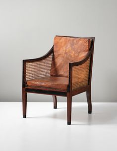 KAARE KLINT 'The English chair', 1930s  Cuban mahogany, ebony, Nigerien leather, cane. Each: 90.2 x 61.1 x 64 cm (35 1/2 x 24 x 25 1/4 in.) ...