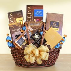 Celebrate Godiva Executive Style.  When you need to make a big impression, send the very best of the best from Godiva. Our executive selection boasts a delectable variety of Godiva favorites. To be enjoyed & savored morning, noon or evening, this lavish gift basket features robustly flavorful Godiva premium roast coffee, along with dreamy milk chocolate and dark chocolate cocoa. As you enjoy your tasty hot beverages, treat yourself to Godiva heart shaped chocolate biscuits & more.