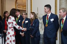 Kate Middleton oozed elegance in an ankle-grazing white Alexander McQueen dress which was ...