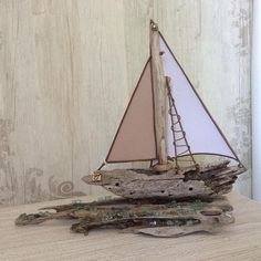 Another one UNIQUE handmade driftwood ship with fabric, rope and broken glass. The wood is collected at the Greek islands and its all natural without any process of forming it. Here we have a gorgeus coastal inspired ship model. It is ideal to decorate a cottage, house near the