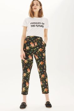Get your work-day look sorted in these unique floral cigarette trousers. Style with a graphic tee for an edgy touch.