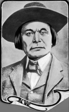 Photomontage, a painted photo, depicts head and shoulders portrait of Crazy Snake, Creek chief and leader of a 1901 anti-allotment uprising.