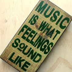 Wood wall sign - Music is what feelings sound like - Hunter green - Words on wood. $35.00, via Etsy.