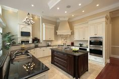 Stone kitchen floors with white cabinets. Get expert assistance on designing & installation of unique kitchen cabinets(http://www.flickr.com/photos/99204361@N05/) Choose from endless styles for your new cabinets. Call 800-845-6779