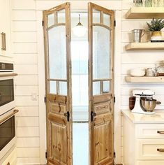 A perfect reclaimed french door set is the perfect addition to this kitchen remodel.