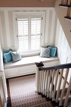 Add a bay window seat in an oversized staircase landing