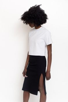 """The Len Rib Skirt in black features a fitted silhouette with side slit detail, elastic fold-in waistband and pairs perfectly with the logan tee. Model is 5'9"""" and wears size x-small. - Runs true to si"""