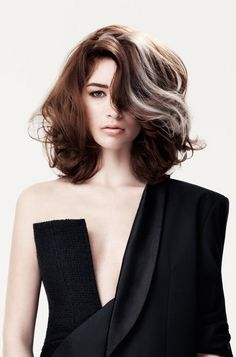 Interesting haircolor technique -- women actually adding streaks of gray to their hair. Very dramatic but takes a lot of confidence. Love the haircut, though. Whether natural or woman-made, the big waves are very trendy for the coming fall.