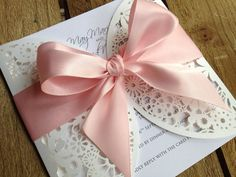Floral lace laser cut pink ivory wedding invitation with large satin bow  on Etsy, $7.80