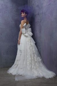 Bridal Gowns and Wedding Dresses by St. Pucchi. This dress is currently available at the West Hollywood salon. Style #511