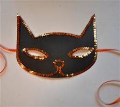 Little kids always want to be cats for Halloween-perfect mask!  Less than 15 minutes to make!  Instructions:  Cut the mask shape from Movable Monsters' cat. Its the basic cut for the cat. Next I put ATG tape around the eyes and the outline of the mask and put orange sequin ribbon over the tape. I adhered some orange ribbon to the back of the mask in 2 different strips one for each side. #Cricut