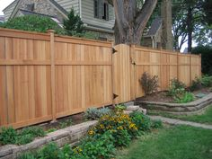 Fence for backyard. Full height for sides and back, lower height near driveway and deck. Two gates (one full height by garage, one shorter height for access to deck).
