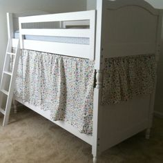 Bunk bed fort I made for Claire using twin flat sheet and pillowcase. Held up with curtain suspension rods.