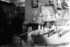#thought #thinking #icecream #walking #stroll #wander #enjoy #chocolate #cream #mirror #reflection #blackwhite #filmisnotdead #trix #1600 #push #leica #streetphotography #urban #life
