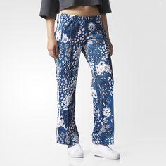 Deze damesbroek heeft een op de jaren 90 geïnspireerde bloemenprint op een achtergrond van winterse kleuren. Het relaxte matrozenbroekmodel met wijde pijpen geeft een stijlvolle look een casual uitstraling.