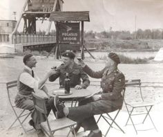 """The return to Pegasus Bridge with the man who led the assault seated center, Major John Howard of """"D"""" Company, 2nd Oxfordshire and Buckinghamshire Light Infantry, 1946"""