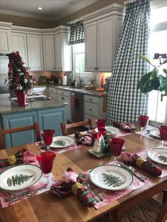 Gorgeous #Spode Christmas Tree plates on red toile placemats with red tartan and toile napkins.  The center of the table features a Spode sandwich tray, Spode tree-shaped bank, and red candle.